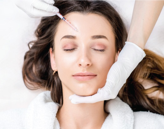 woman receiving Botox injections