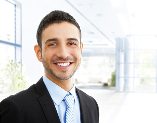 smiling man in business attire